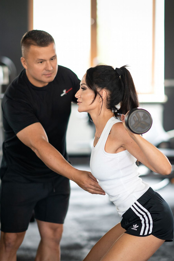 fit woman exercise on electro muscular machine